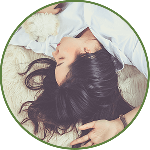 fatigued woman laying on bed - What Are Detox Reactions? Article by Dr. Tara Clapp, ND