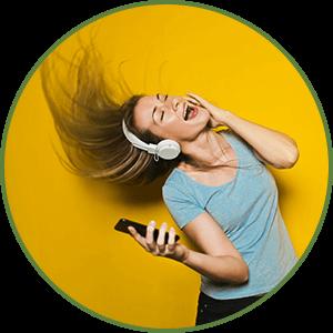 woman dancing to music wearing headphones - More Energy - Benefit of Keto Diet